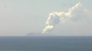 Smoke bellows from Whakaari, also known as White Island, volcano as it erupts in New Zealand, December 9, 2019, in this image obtained via social media.