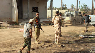Fighters loyal to the UN-recognised Libyan Government of National Accord (GNA) gather amid clashes with rival forces loyal to strongman Khalifa Haftar near Tripoli International Airport on June 3, 2020.