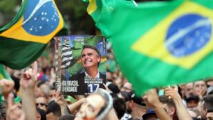 Los partidarios del candidato presidencial brasileño Jair Bolsonaro asisten a una manifestación en la Avenida Paulista en Sao Paulo, Brasil, el 30 de septiembre de 2018.
