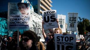 Manifestations de soutien à Edward Snowden et contre l'espionnage massif de la NSA, en octobre 2013 à Washington.