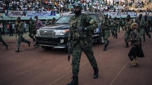 The motorcade of the President of the Central African Republic, arrives at the 20,000-seat stadium, for an electoral rally, escorted by the presidential guard, Russian mercenaries, and Rwandan UN peacekeepers, in Bangui, on December 19, 2020.