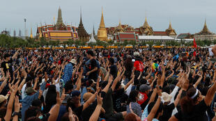 Thailand protesters royal palace three fingers