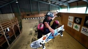 """Flying high: Misugu Okamoto shows off her skateboarding skills during training.""""I love the challenge of trying new techniques -- I get obsessed with that."""""""