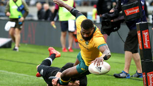 Australia's Marika Koroibete scores a try during the Bledisloe Cup rugby union match between New Zealand and Australia in Wellington on October 11, 2020.