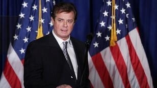 Chip Somodevilla, Getty Images / AFP | This file photo taken on April 27, 2016 shows Paul Manafort, advisor to Republican presidential candidate Donald Trump's campaign, checking the teleprompters before Trump's speech at the Mayflower Hotel in Washington, DC