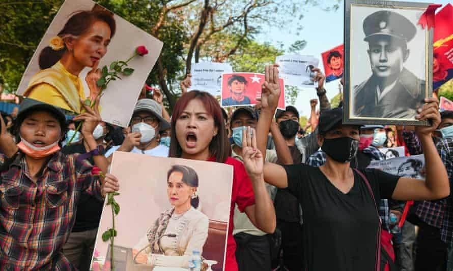 "Protesters in Yangon display the three-finger ""Hunger Games"" salute."