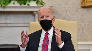 American President Joe Biden in the Oval Office at the White House, Washington DC, January 29 2021.
