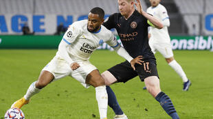 Olympique de Marseille's Jordan Amavi in action with Manchester City's Kevin De Bruyne at the Orange Velodrome in Marseille, France on October 27, 2020.