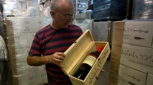 Amichai Luria shows off a bottle of his wine at the Shiloh winery in a Jewish settlement in the occupied West Bank in November 2015 -- one of his wines was at the center of the case in Canada on country of origin labeling