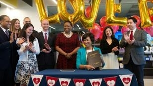 Washington Mayor Muriel Bowser signs the LOVE Act to allow city officials to certify weddings in the district during the government shutdown that closed the local Wedding Bureau on January 11, 2019