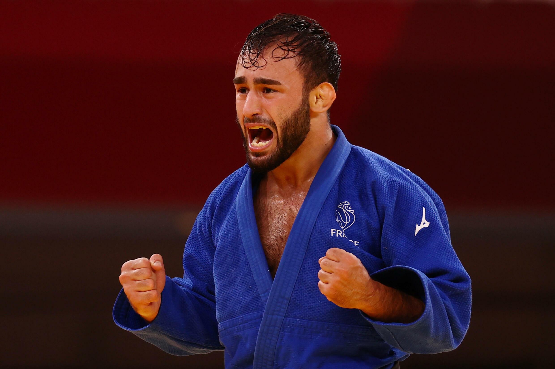 Luka Mkheidze réagit après sa victoire lui offrant la médaille de bronze, le 24 juillet 2021 à Tokyo.