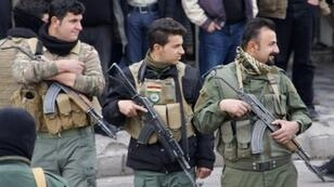 قوات كردية خلال مظاهرات في السليمانية بشمال العراق في 19 ك1/ديسمبر 2017