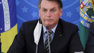 Brazil's President Jair Bolsonaro has faced nightly protests for weeks over his handling of the coronavirus crisis; he is pictured March 18, 2020