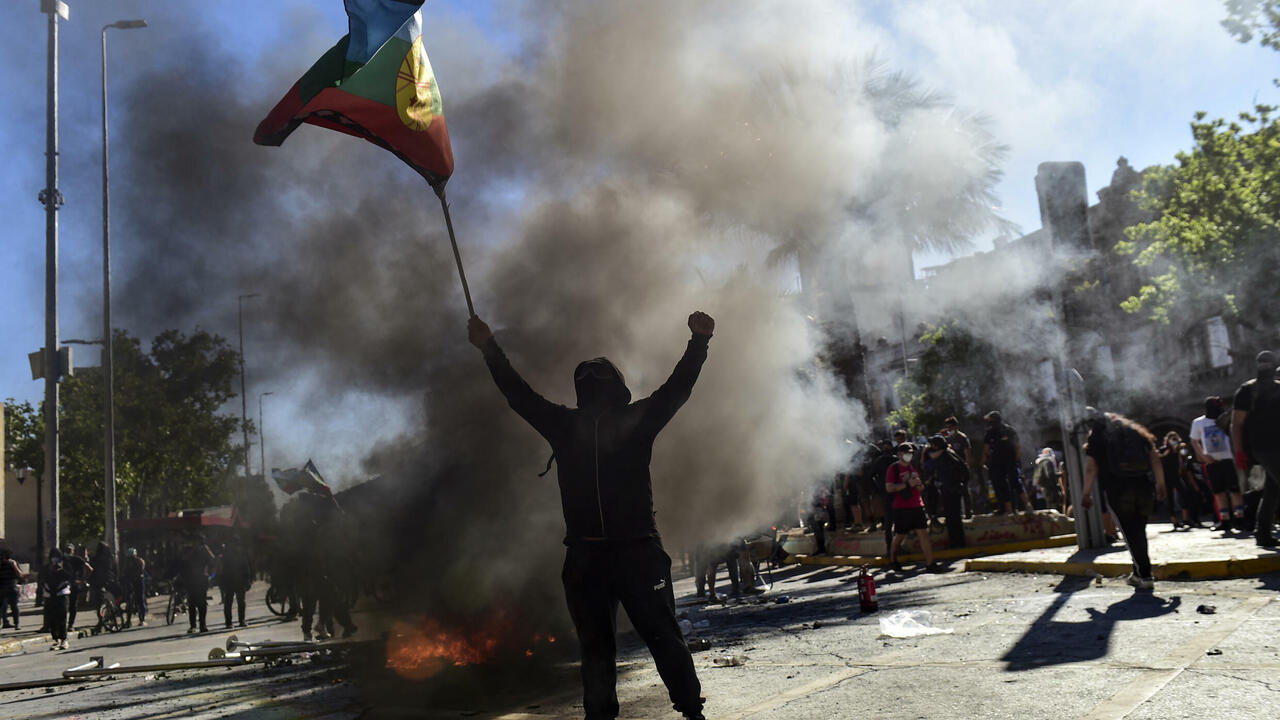 Image Two dead, 450 arrested in Chile protest violence