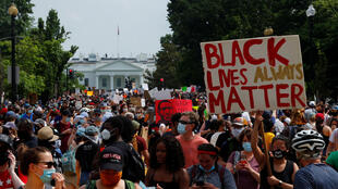 Demonstrators gather in front of the White House during a protest against racial inequality in the aftermath of the death in Minneapolis police custody of George Floyd, in Washington, D.C., on June 6, 2020.
