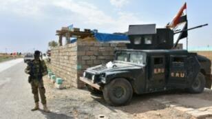 قوات الجيش العراقي عند موقع استعادت السيطرة عليه من قوات البشمركة بالقرب من محافظة كركوك في 13 تشرين الأول/أكتوبر 2017
