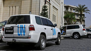 A UN vehicle is seen outside the hotel where experts from the Organisation for the Prohibition of Chemical Weapons (OPCW) were staying in Damascus on April 19, 2018.