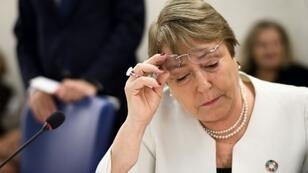 """Two demonstrators ran onstage as UN rights chief Michelle Bachelet (pictured September 2018) addressed a large crowd at the Universeity of Geneva, waving a banner calling for """"Human Rights for Mapuche"""", the indigenous community in Chile"""