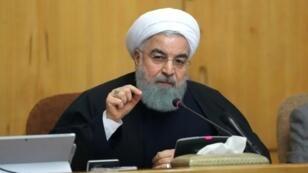 الرئيس الإيراني حسن روحاني متحدثا خلال اجتماع للحكومة في طهران في 31 كانون الأول/ديسمبر 2017
