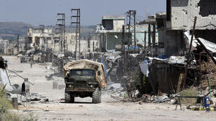 صورة لقوات الجيش السوري في بلدة كفر نبودة، على بعد حوالي 40 كم شمال حماة، في 11 مايو/أيار 2019.