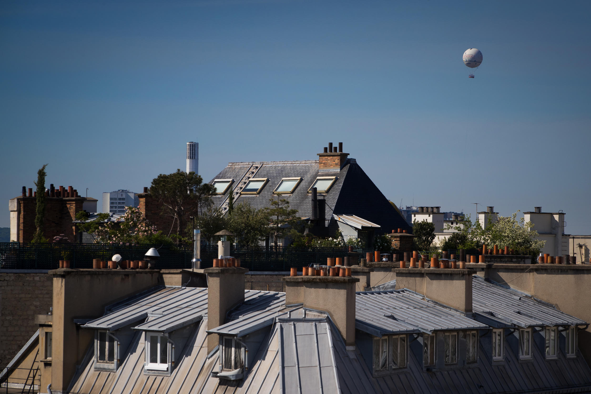 The weather balloon run by Airparif, the organisation responsible for monitoring the air quality in the greater Paris area, flies over the French capital on May 7, 2020, during France's first Covid-19 lockdown.