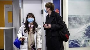 Air travellers wear masks as they arrive at Ivalo Airport, Finland January 24, 2020 OK