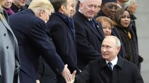 Russian President Vladimir Putin (R) shakes hands with US counterpart Donald Trump before a ceremony at the Arc de Triomphe in Paris on November 11, 2018 as part of commemorations marking the 100th anniversary of the 1918 armistice