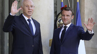 French President Emmanuel Macron greeting the press next to Tunisian President Kais Saied at the Elysée Palace in Paris, June 22 2020.