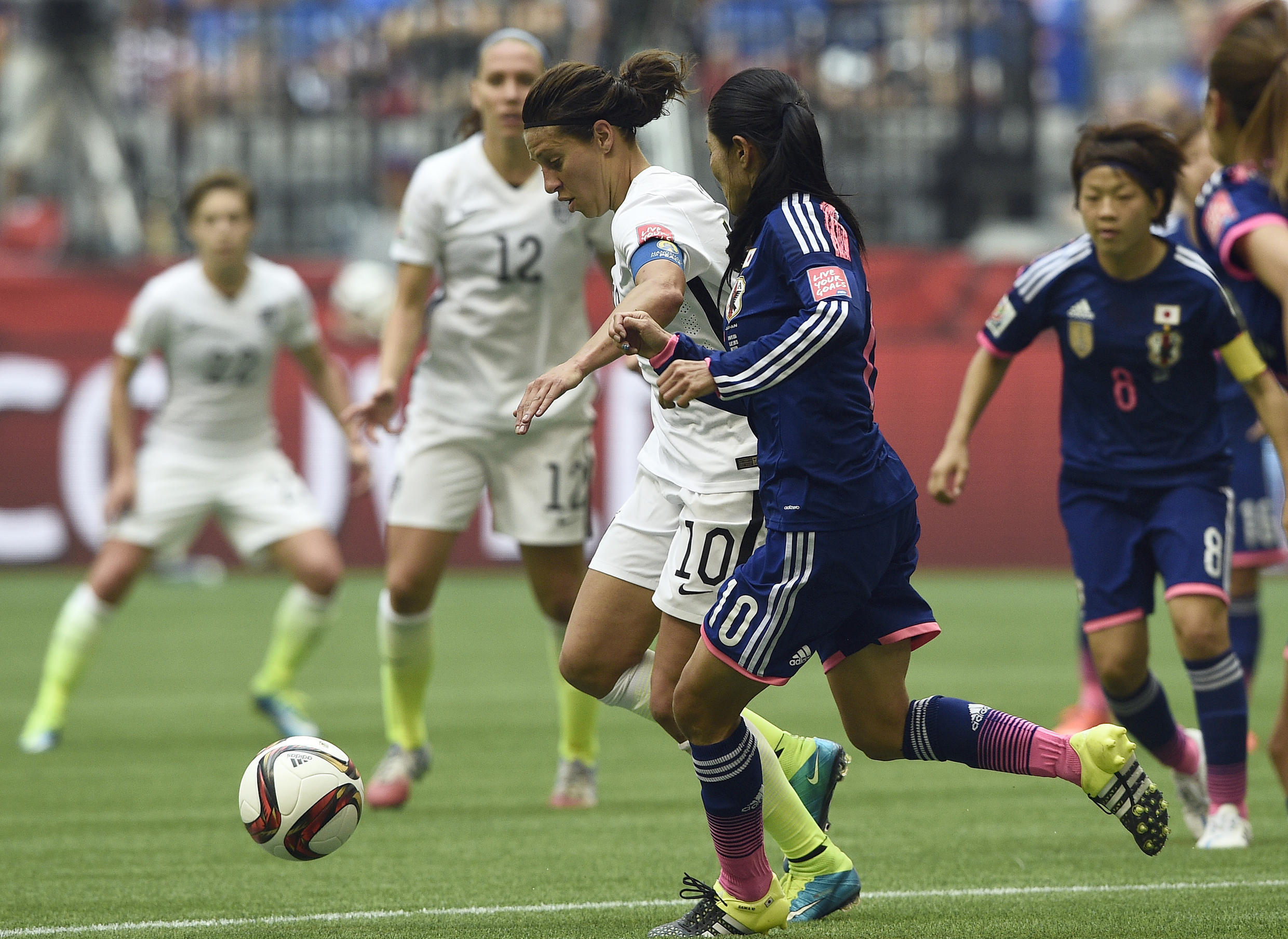 Japan's midfielder Homare Sawa (R) vies with USA midfielder Carli Lloyd during the final football match between USA and Japan during their 2015 FIFA Women's World Cup at the BC Place Stadium in Vancouver on July 5, 2015.