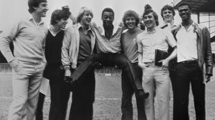 Kenny Sansom (third from right) is pictured with Brazilian great Pele and some of his Arsenal teammates at Highbury Stadium in London in May 1981