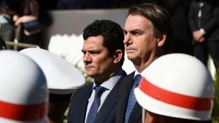 Brazilian President Jair Bolsonaro (R) and his Justice Minister Sergio Moro, who is under fire over accusations he acted improperly as a judge in a sprawling corruption case