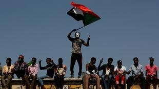 A Sudanese protester outside the defence ministry compound in Khartoum, Sudan, April 24, 2019. REUTERS Ok