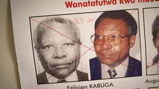 The date of arrest and a red cross are written on the face of Felicien Kabuga, one of the last key suspects in the 1994 Rwandan genocide, on a wanted poster at the Genocide Fugitive Tracking Unit office in Kigali