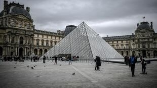 Visitors outside the Pyramide du Louvre, the museum's main entrance, on February 28, 2020.