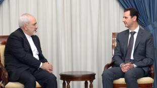 الرئيس السوري بشار الأسد ووزير الخارجية الإيراني محمد جواد ظريف
